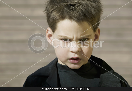 Close Up of a Boy with Attitude stock photo, Cloce-up of a young boy with a defiant attitude. by Scott Griessel
