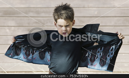 Boy opening his shirt stock photo, Young boy with his shirt stretched out like wings by Scott Griessel