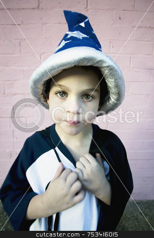 Wizard Boy stock photo, Young boy in a wizard costume pulling at his string tie by Scott Griessel