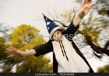 Wizard Boy with hands outstreached stock photo, Young boy in a wizard costume with his arms outstretched by Scott Griessel