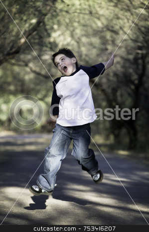 Boy in the Air stock photo, Young boy on a tree-lined path jumps in the air. by Scott Griessel