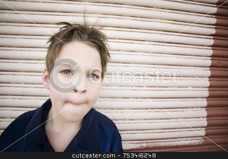 Boy Making A Curious Face stock photo, Young Boy with Looking Curious and Pursing His Lips by Scott Griessel