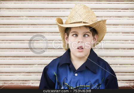 Cross-Eyed Boy in a Cowboy Hat stock photo, Young Boy in a Straw Cowboy hat Crosses His Eyes by Scott Griessel