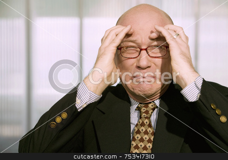 Horrified Businessman stock photo, Horrified businessman with a hands to his forehead by Scott Griessel
