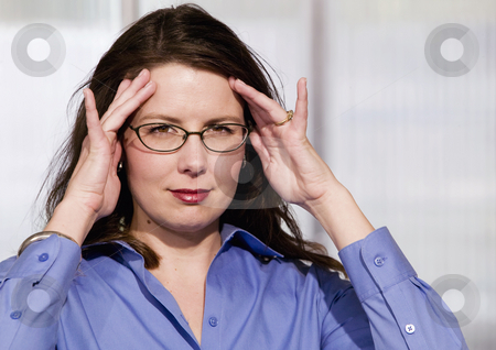 Frustrated Business Woman stock photo, Mildly Frustrated Business Woman with her Hands at her Temples by Scott Griessel