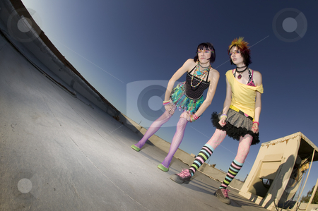 Girls on the Roof stock photo, Fisheye shot of girls in brightly colored clothing on a roof by Scott Griessel