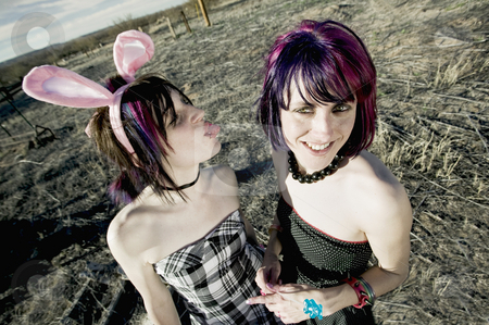 Fun Girls stock photo, Punk girl sticking her tongue out at her friend by Scott Griessel