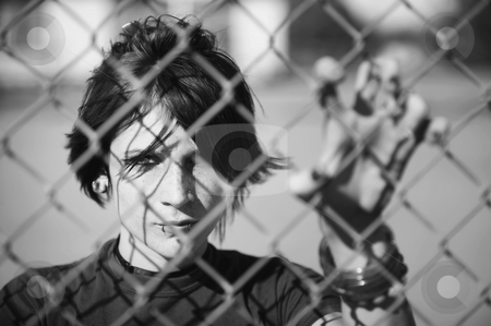 Punk Girl Behind Chain Link stock photo, Young Punk Girl Being Shadowed By Chain Link by Scott Griessel
