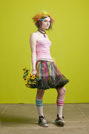 Punk woman with plastic flowers stock photo, Pretty young woman with colorful punk clothes with plastic flowers. by Scott Griessel
