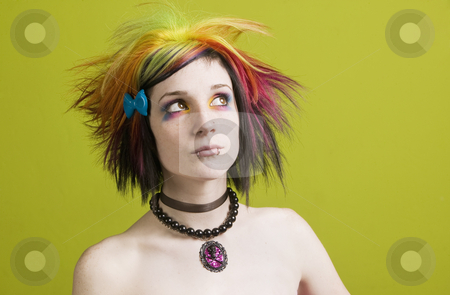 Punk woman with bright makeup and bare shoulders stock photo, Close-up of a woman with bright mascara, colorful hair and bare shoulders by Scott Griessel