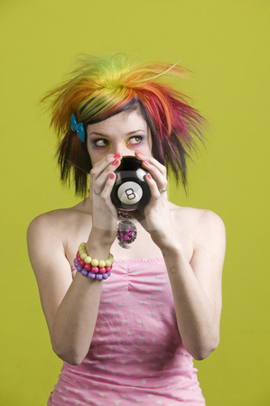 Punk woman with reading the future looks up stock photo, Close-up of a woman with bright mascara and colorful hair predicts the future and looks up to the right by Scott Griessel