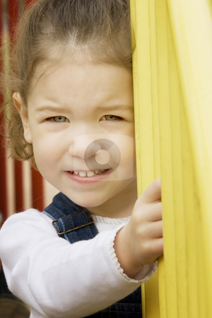 Close up of a little girl on playground equipment stock photo, Little girl on play equipment smiles at the camera by Scott Griessel
