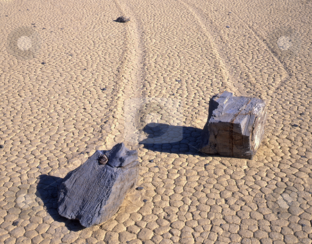 Double Rock Trails 2 stock photo, Two rocks and theie trails on the Racetrack Playa in Death Valley National Park, California. by Mike Norton