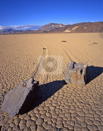 Double Rock Trails 1 stock photo, Two rocks and their trails on the Racetrack Playa in Death Valley National Park, California. by Mike Norton