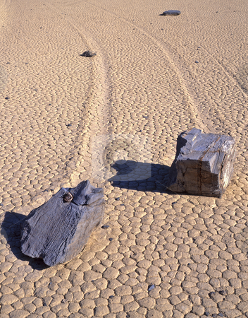 Double Rock Trails 3 stock photo, Two rocks and their trails on the Racetrack Playa in Death Valley National Park, California. by Mike Norton