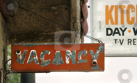 Vacancy Sign stock photo, Decrepit and peeling orange motel vacancy sign. by Scott Griessel