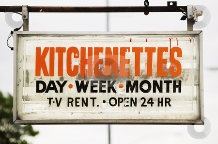 Motel Sign stock photo, Motel sign advertising rooms with kitchenettes. by Scott Griessel