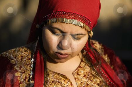 Muslim Woman Outdoors stock photo, Muslim woman wearing a head scarf outdoors by Scott Griessel
