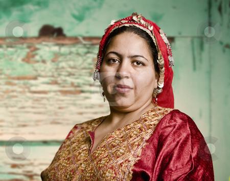 Muslim Woman stock photo, Portrait of a Muslim Woman in an Ornate Head Scarf by Scott Griessel