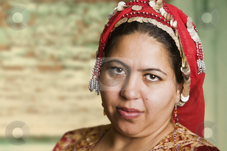 Muslim Woman stock photo, Portrait of a Muslim Woman in an Ornate Head Scarf by Scott Griessel