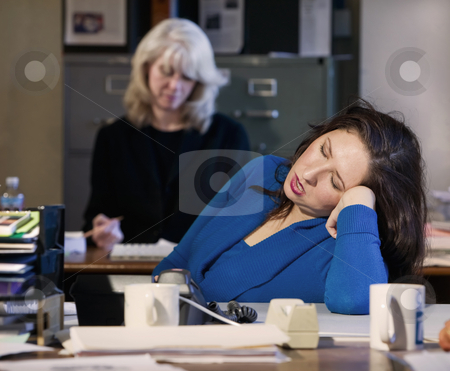 Office Nap stock photo, Hispanic woman sleeps at her office desk by Scott Griessel