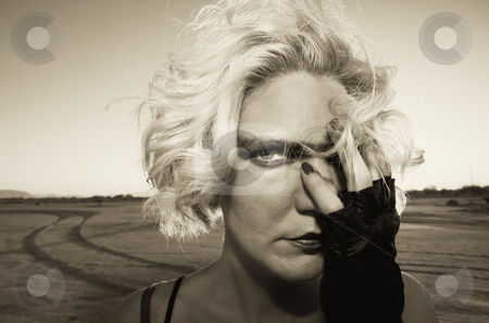 Science Fiction Model stock photo, Female science fiction model close up in a desolate location. by Scott Griessel