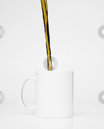 White Cup Coffee Pour stock photo, Streeam of coffee pours into a white mug against a white background. by Scott Griessel