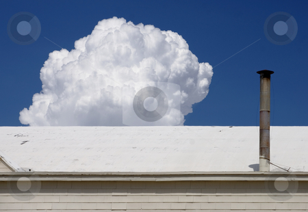 White Hangar stock photo, White airport hangar roof with cloud building in the background. by Scott Griessel