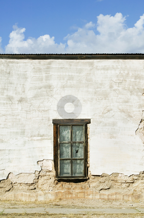 Window on an Abandoned Adobe Building stock photo, Window with curtains on a boarded and abandoned adobe building. by Scott Griessel