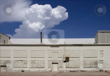 White Hangar and a Storm Brewing stock photo, White airport hangar. by Scott Griessel