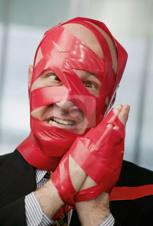 Red Tape stock photo, Cross-eyed businessman wrapped in red tape by Scott Griessel
