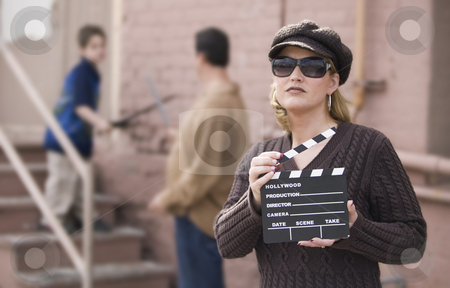 Family Movie stock photo, Woman holding a film slate in front of a man and boy by Scott Griessel