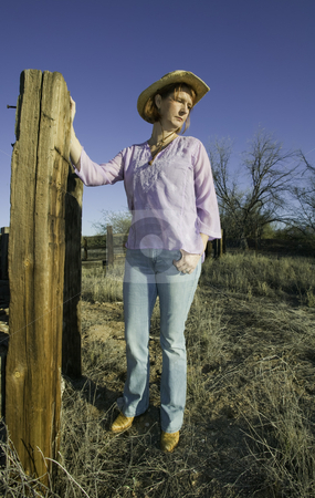 Woman in a Cowboy Hat stock photo, Woman wearing a cowboy hat in a rural setting. by Scott Griessel