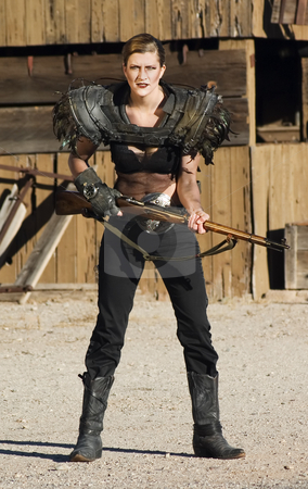 Anachronistic Gangster Woman stock photo, Science fiction woman from the future carrying a rifle. by Scott Griessel