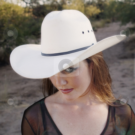 Cowgirl stock photo, Pretty country woman in a white cowboy hat. by Scott Griessel