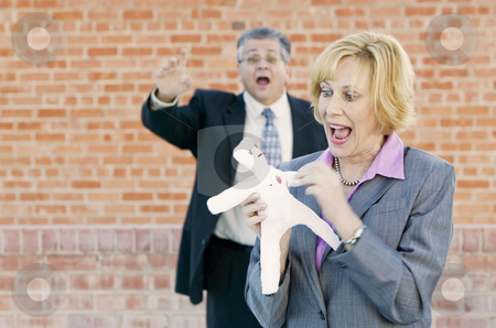 Executive Voodoo stock photo, Executive pokes a pin into a Voddoo doll representing her boss or coworker by Scott Griessel
