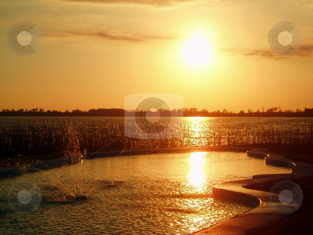 Sunset stock photo, Sunset over a lake nice orange tones. by Lucy Clark