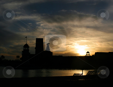 Silhouette Sunset stock photo, The silhouettes of a hotel at sunset. by Lucy Clark