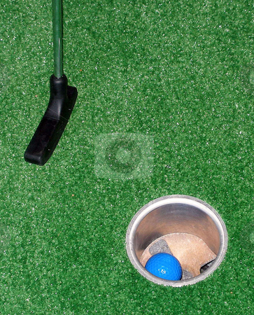Adventure Golf stock photo, Playing Adventure Golf, club, ball and hole. by Lucy Clark