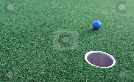 Adventure Golf stock photo, Adventure Golf, ball rolling towards hole. by Lucy Clark