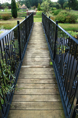 A Bridge to... stock photo, A bridge over a lake in a garden. by Lucy Clark