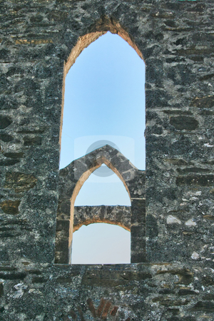 Arched Window stock photo, An old historic arched window with blue sky background by Kevin Tietz