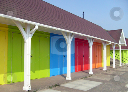 Colorful beach chalets by seaside stock photo, Colorful beach chalets by seaside, Scarborough North Bay, England, U.K. by Martin Crowdy