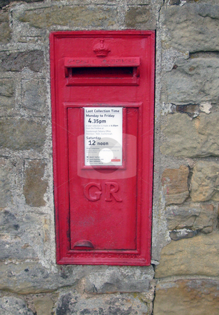 Red British post box stock photo, Red British post box on wall in rural setting. by Martin Crowdy