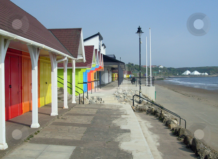 Colorful beach chalets by seaside stock photo, Colorful beach chalets by seaside, Scarborough North Bay, England, U.K. by Martin Crowdy