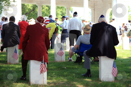 Memorial Day stock photo, Veterans sitting on head stones listing to memorial day speech by Jack Schiffer