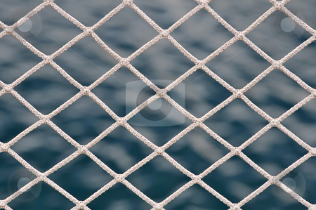 Net stock photo, Close-up of net against a dark blue sea by Massimiliano Leban