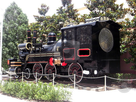The Train On Display stock photo, A unique black model train stands on display at a themepark in Orlando by Rebecca Mosoetsa
