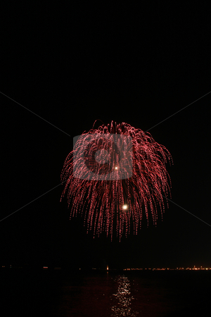 Red hairy ball fireworks stock photo, Red hairy ball fireworks by the bay by Jonas Marcos San Luis