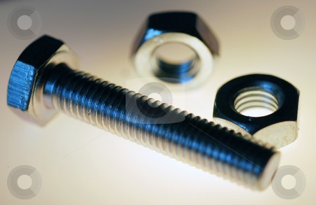 Hex Head Screw and Accessories stock photo, A back lit close up photograph of a hex head screw by Philippa Willitts